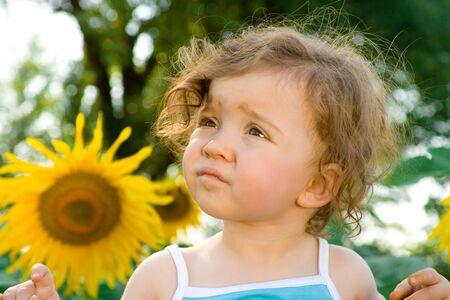 girl in sunflower field Stock Photo - 3391030