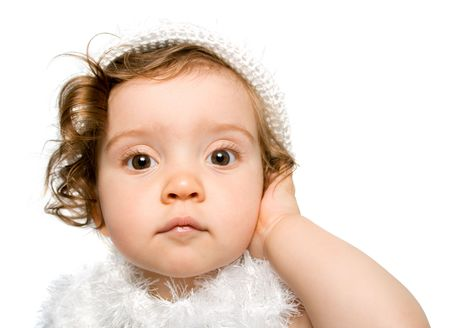 pretty curly-headed baby girl in white dress and hat, her eyes wide open, isolated,  obn white background Stock Photo - 3391009