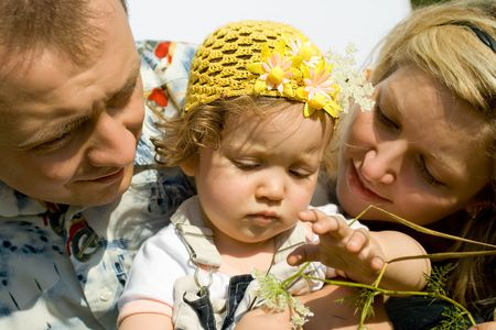 Cute  girl with her mom and dad playing in the meadow Stock Photo - 3447843