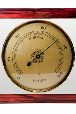 Vintage hygrometer in wooden frame, isolated photo