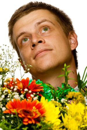 Portrait of a dreaming or enamored young man with flowers, isolated, on white background Stock Photo - 3470140