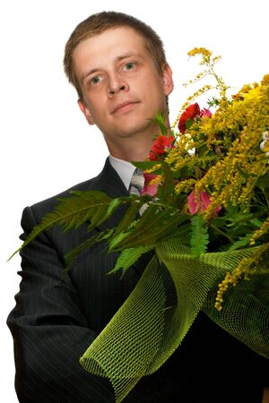 Man in black suit holding a big bunch of flowers, isolated, on white background Stock Photo - 3500088