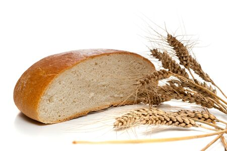 barley head: Half of bread loaf and wheat spikes, isolated, on white background Stock Photo