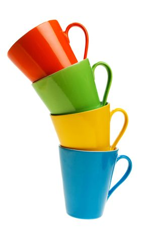 Multicolored cups in stack, isolated, on white background photo