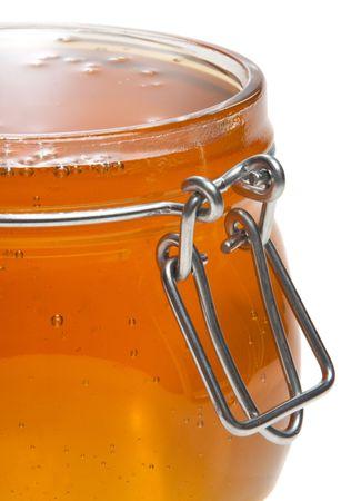 Jar full of honey, isolated photo