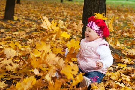 Laughing toddler and falling golden leaves Stock Photo - 3715712