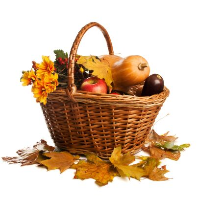 Fruit and vegetables, lying in wicker basket, isolated photo