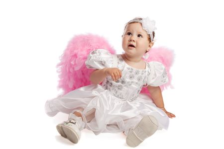 Little girl in pink wings looking up, isolated photo