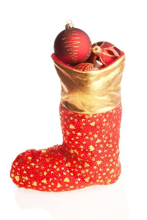 Christmas boot with red balls inside, isolated photo