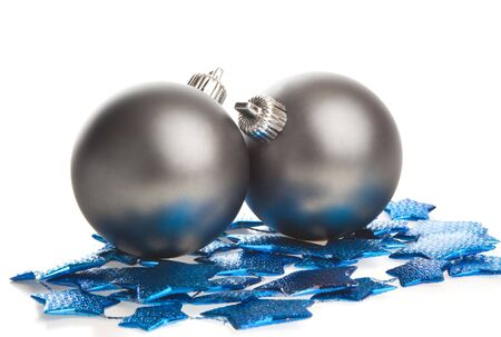 Two dark gray balls lying on blue stars, isolated photo