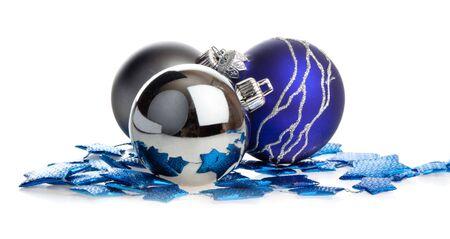 Christmas balls lying on blue stars, isolated photo