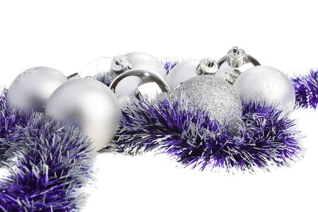 Silver Xmas balls and purple tinsel, isolated photo