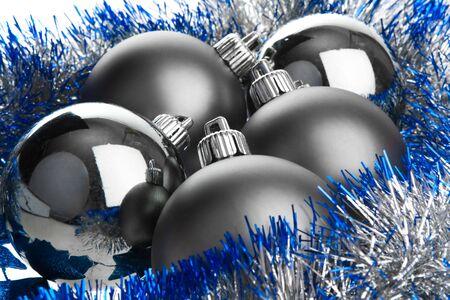 Dark balls on silver tinsel photo