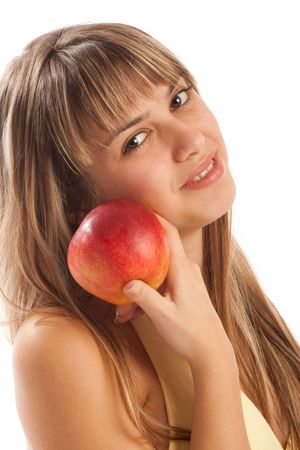 Portrait of an attractive girl in yellow dress holding a red apple photo