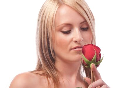 Portrait of a girl looking at red rose photo