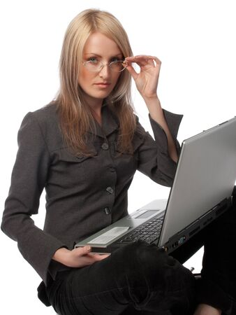 Girl in glasses sitting with laptop, isolated Stock Photo - 3858544
