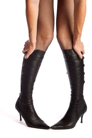 Legs in net pantyhose and boots, isolated Stock Photo - 3865509