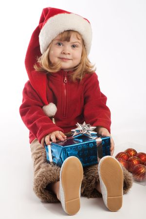 Little girl in Santa hat holding present box Stock Photo - 3868437