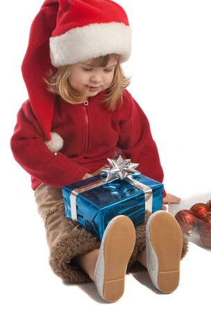Little santa helper looking at her present box Stock Photo - 3873346