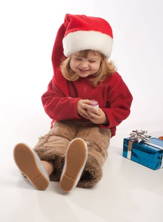 Little girl in Santa red hat playing Stock Photo - 3873341