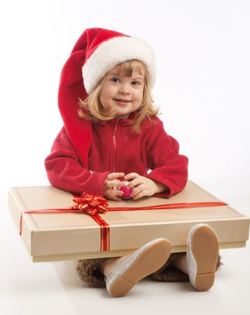 Little girl in Santa hat sitting with large present box Stock Photo - 3873343