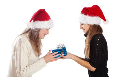 Young woman giving Xmas present to her friend, isolated photo
