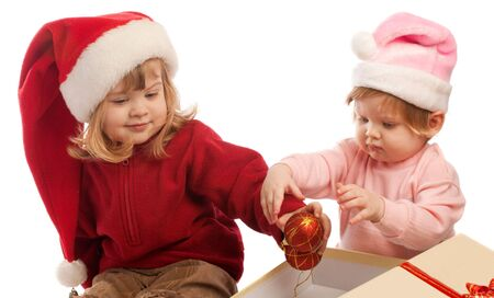 Two sweet little girls in Santa hats, isolated Stock Photo - 3884134