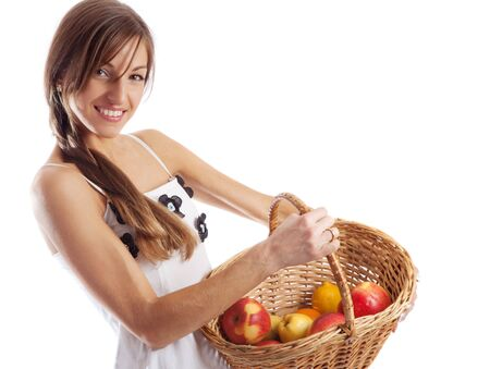 Portrait of a smiling country girl holding basket with  apples photo