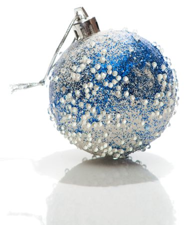Blue and white Xmas ball with transparent drops on it, isolated photo