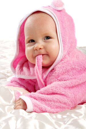 Baby in pink after bath, isolated photo