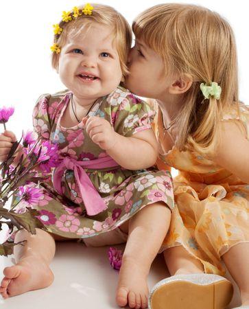 Pretty little girl kissing her sister Stock Photo - 3918057