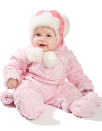Smiling baby in pink winter clothes, isolated photo