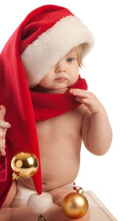 Kid in Santa hat and red scarf, isolated Stock Photo - 3932945