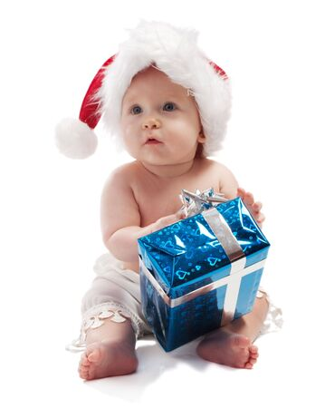 Baby in red Xmas holding blue present box, isolated photo