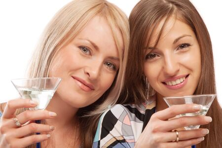 Two beautiful friends drinking vermouth, isolated photo