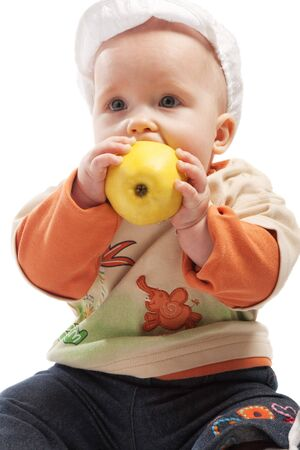 Kid in white cap eating yellow apple, isolated Stock Photo - 3939707