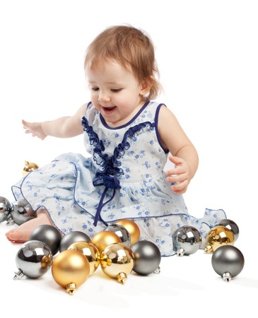 Little girl playing with Christmas balls, isolated photo
