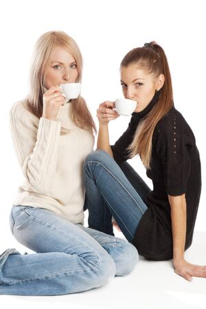 Two beautiful friends having coffee, isolated photo