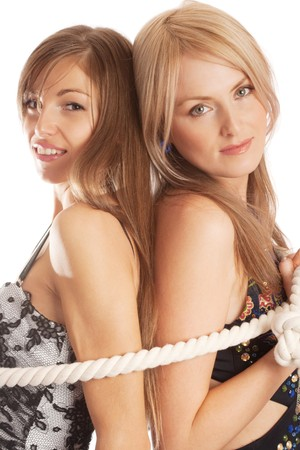 Two beautiful women tied with rope, isolated photo