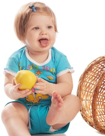 Baby with yellow apple, isolated photo
