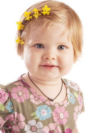 Smiling red-haired little girl photo