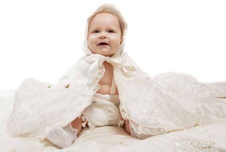 baptismal: Smiling baby in white silk baptismal clothes Stock Photo