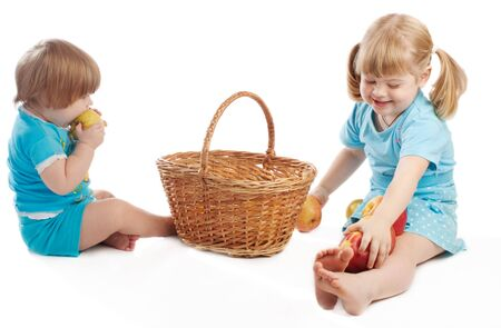 Sisters eating and playing with apples Stock Photo - 3989393
