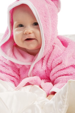 Smiling baby in pink hooded bathgown photo