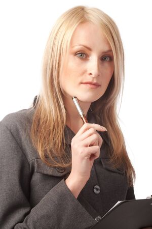 Portrait of a thoughtful young woman holding pen and clipboard photo