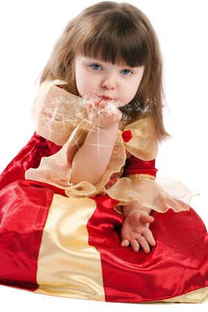 Beautiful little princess blowing stars photo