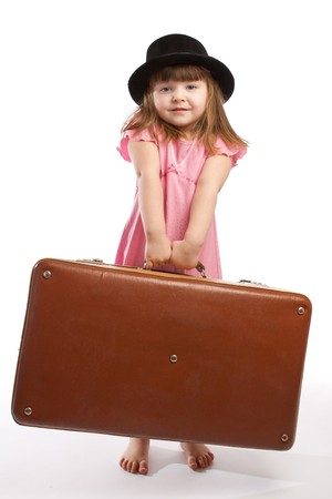Girl in black hat carrying old suitcase photo
