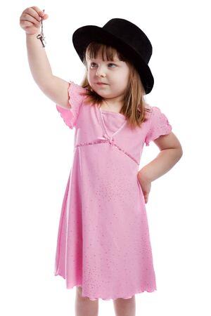 Adorable girl holding  keys, isolated Stock Photo - 4041378