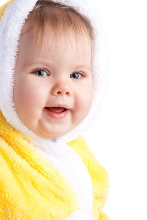 Smiling baby girl in yellow hood, isolated photo