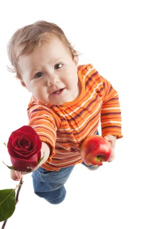 amour: Kid giving a red rose, isolated